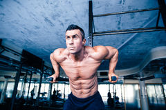 Young muscular man workout on bars Stock Photo