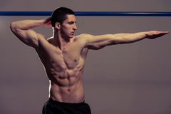 Young Muscular Men Flexing Muscles Stock Photography