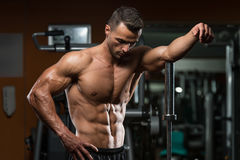 Young Muscular Men Resting After Exercises Royalty Free Stock Image
