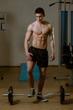 Young Muscular Men Standing By The Barbell Stock Photos