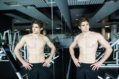 Young muscular man workout in gym near the mirror shadows stock photos