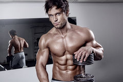 Young muscular sexy man workout in gym Royalty Free Stock Image