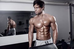Young muscular sexy man workout in gym Royalty Free Stock Images