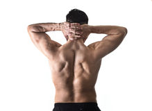 Young muscular sport man holding sore neck massaging cervical area suffering body pain. Back of young muscular sport man holding sore neck with his hands and Royalty Free Stock Photography