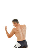 Young muscular sports guy with naked torso boxing Stock Photos