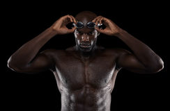 Young muscular swimmer with goggles Royalty Free Stock Images