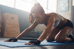 Young muscular woman doing stretching workout royalty free stock photo