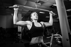 Young muscular woman doing workout Royalty Free Stock Image