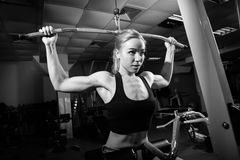 Young muscular woman doing workout Stock Images