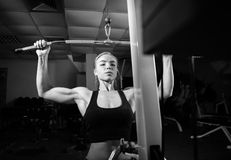 Young muscular woman doing workout Royalty Free Stock Photo