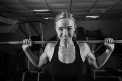 Young muscular woman doing workout Royalty Free Stock Photography