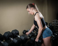 Young muscular woman doing workout Royalty Free Stock Photos
