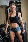 Young muscular woman doing workout Stock Photos