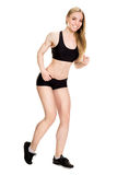 Young muscular woman posing Royalty Free Stock Photography