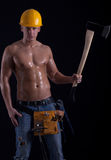 Young muscular worker holding hatchet Royalty Free Stock Photos