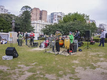Young Musical Band Playing in the Park Royalty Free Stock Image