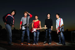 Young musical band posing at dusk Stock Photography