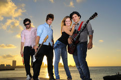 Young musical band posing outdoors Royalty Free Stock Photos