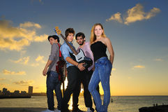 Young musical band posing outdoors with attitude stock photos