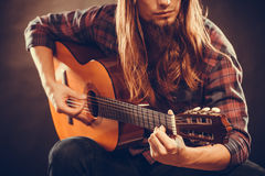 Young musican practicing with guitar. Stock Images