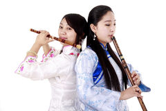 Young musician. Two Chinese musicians in traditional dress playing bamboo flute on white Stock Photos