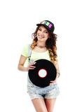 Young Musician in Baseball Hat with Retro Vinyl DIsc Stock Photo