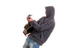 Young musician in black hoodie playing the guitar and dance Royalty Free Stock Image