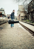 Young musician with case in hand is looking away Royalty Free Stock Photos