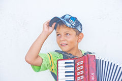 Young musician in Fira, Santorini. Stock Photos