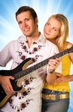 Young musician with a girl Royalty Free Stock Images