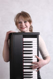Young musician with her keyboard Royalty Free Stock Images