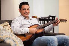 Young musician at home Royalty Free Stock Image