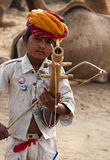 The young musician. A little boy playing music in Pushkar fair, India Stock Photos