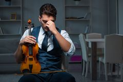 The young musician man practicing playing violin at home Royalty Free Stock Photography