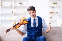 The young musician man practicing playing violin at home Royalty Free Stock Photos
