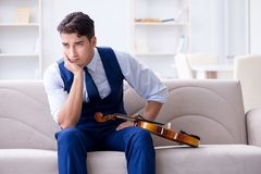 The young musician man practicing playing violin at home Stock Photo