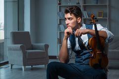 The young musician man practicing playing violin at home. Young musician man practicing playing violin at home Stock Photos