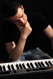Young musician, a pianist Stock Photos