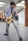 Young musician play on guitar at metro station Royalty Free Stock Photo