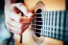 Young musician playing acoustic guitar Royalty Free Stock Photo