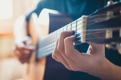 Young musician playing acoustic guitar Royalty Free Stock Images