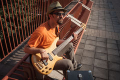 Young musician playing bass guitar Royalty Free Stock Photography