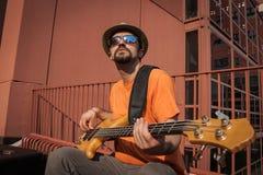 Young musician playing bass guitar Stock Photos