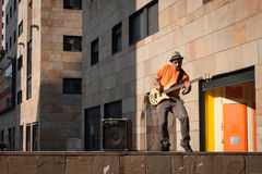 Young musician playing bass guitar Royalty Free Stock Image