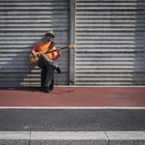 Young musician playing bass guitar Stock Images