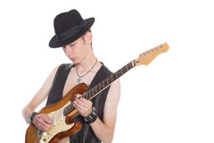 Young musician playing on electric guitar Stock Photo