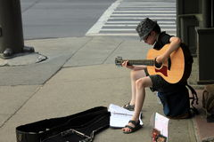 Young musician playing origional music on street corner,Saratoga Springs,New 2012 Stock Photography
