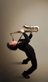 Young musician playing on saxophone Stock Images