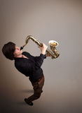 Young musician playing on saxophone Stock Photo