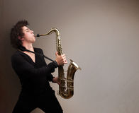 Young musician playing on saxophone Royalty Free Stock Photos